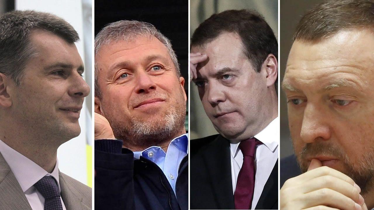 Melania Trump rechaza, una vez más, la mano de su marido.Mijaíl Projorov, Roman Abramovich, Dimitri Medvedev y Oleg Deripaska