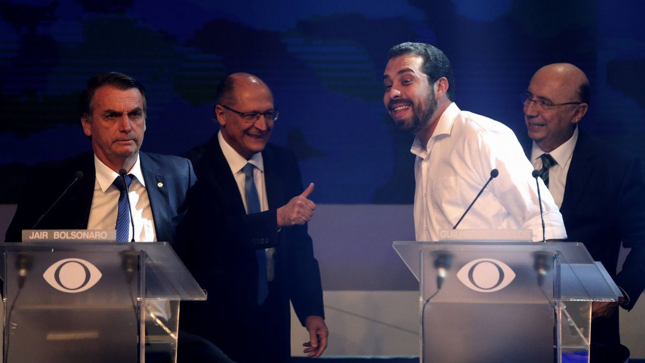 .Bolsonaro, Alckmin, Boulos y Meirelles, durante el debate electoral en Sao Paulo