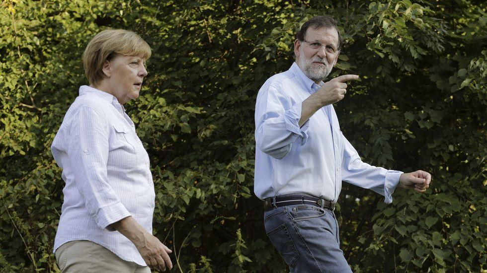 Merkel recibe a Rajoy en el castillo de Messeberg.