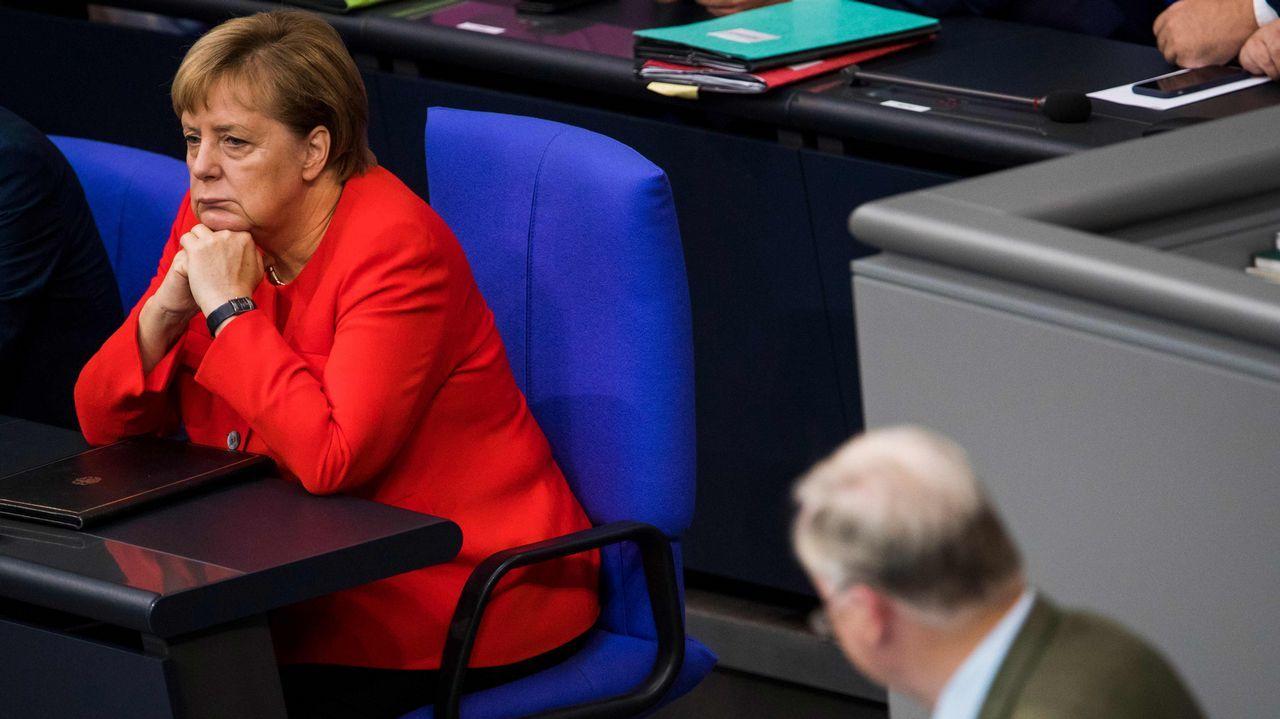 .Merkel, durante la intervención del líder de AfD