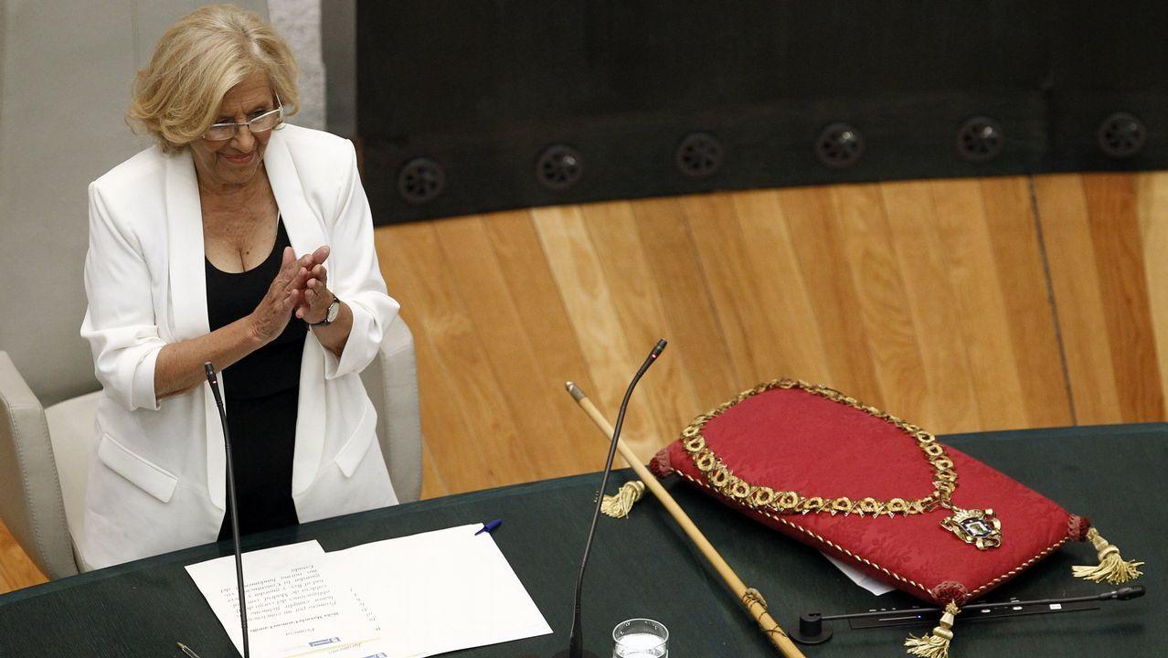 Carmena: «He cambiado de opinión porque tengo unos buenísimos concejales que me han vuelto a convencer».Casado se estrenaba ayer como líder del PP en el Congreso