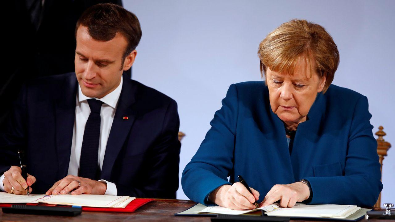 Nicolás Maduro canta «Que viva España».Marcon y Merkel firman el nuevo tratado en el ayuntamiento de la localidad alemana de Aquisgrán