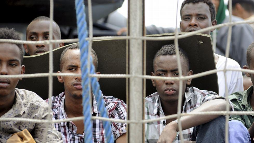 Inmigrantes rescatados en el Mediterráneo.Obama en su visita a Kruen, Alemania