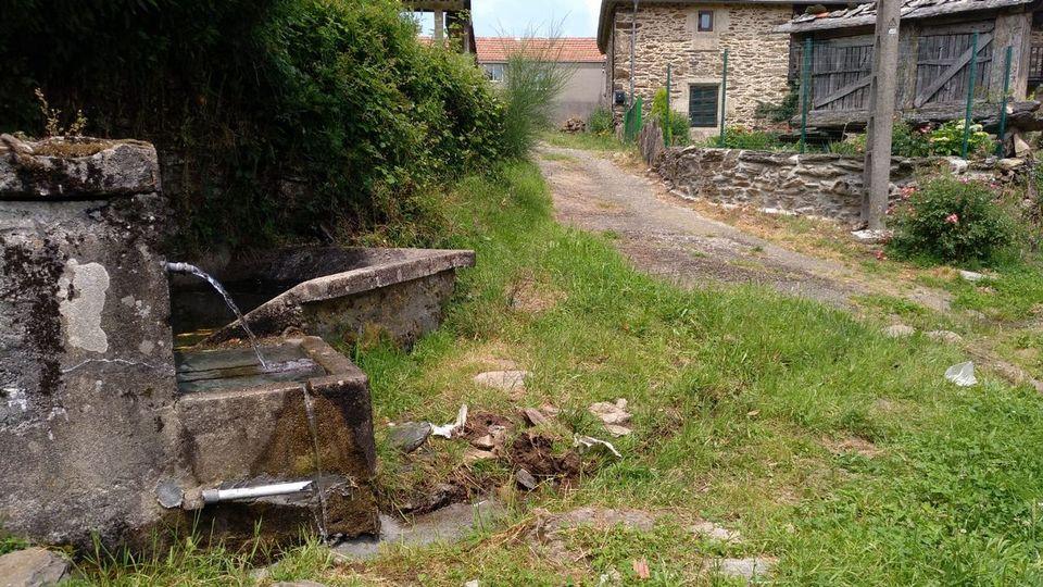 Vecinos de Acevedo exigen la reparación de una pista que lleva 40 años sin asfaltar