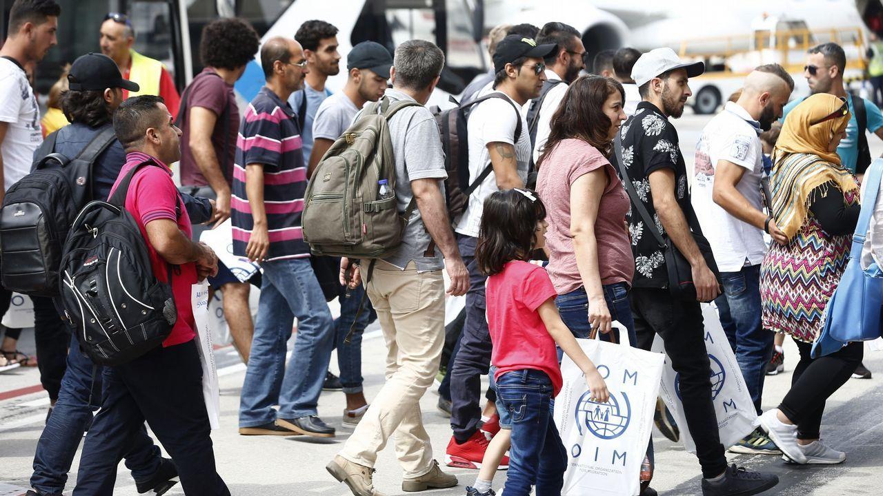 La Junta General acoge el acto oficial por el Día Mundial del Refugiado.Fotografía cedida por la presidencia del Gobierno con Merkel, Sánchez y Tsipras