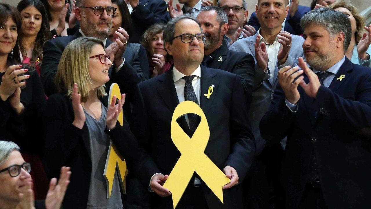 Quim Torra: «Nuestro presidente es Carles Puigdemont».Roger Torrent