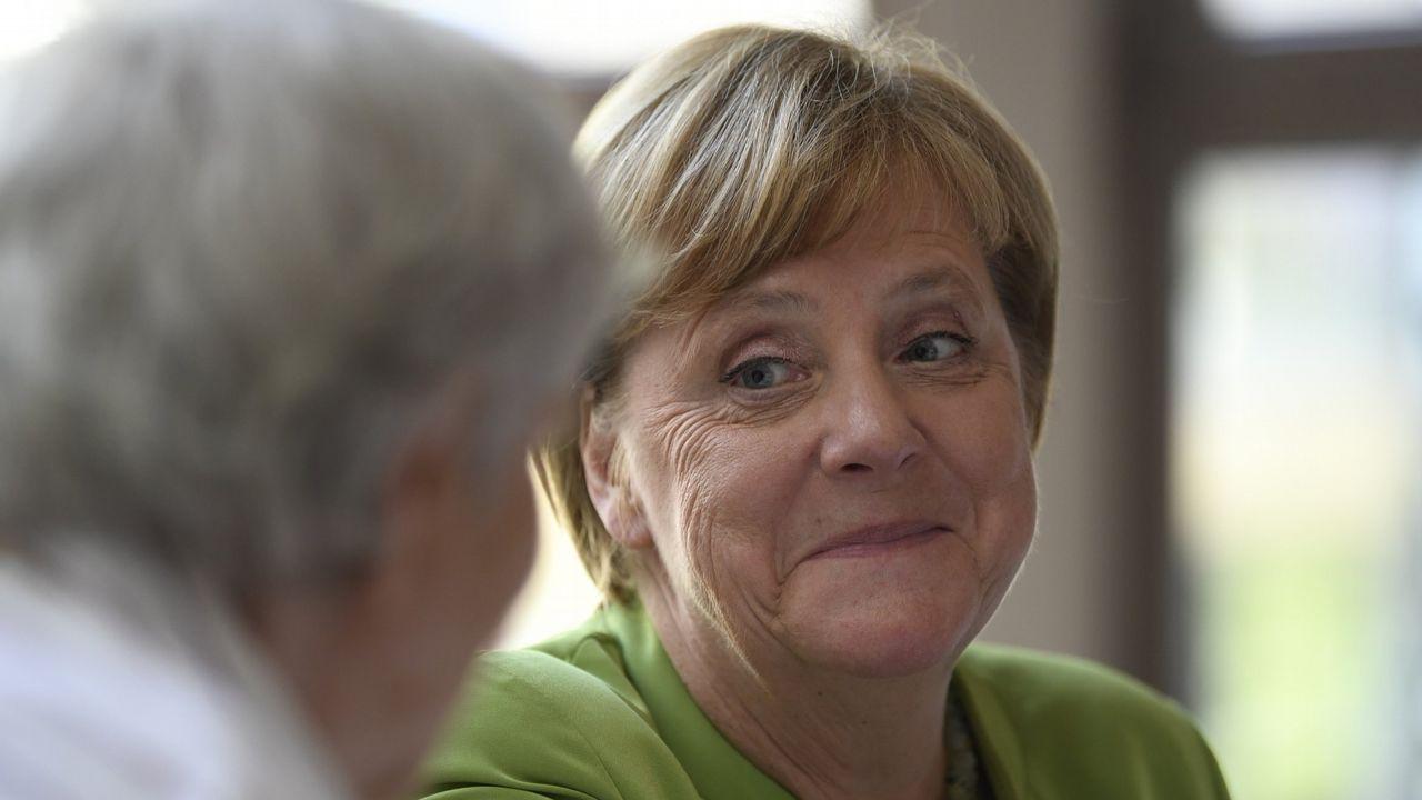 Visita de Angela Merkel a España para reunirse con Pedro Sánchez.Cohen, con corbata azul, era el abogado de confianza de Trump