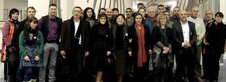 Técnicos de la Dirección General de Agricultura de la Comisión Europea y la comitiva de productores, docentes de la USC y políticos del BNG
