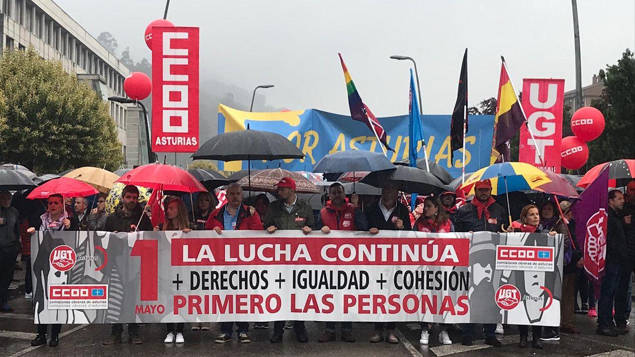 La manifestación del 1 de Mayo en Mieres en imágenes.Los trabajadores de Alcoa en la manifestación del 1 de Mayo en Mieres