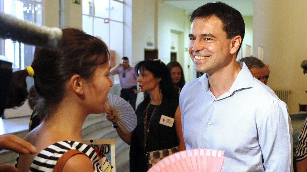 Andrés Herzog, a la derecha