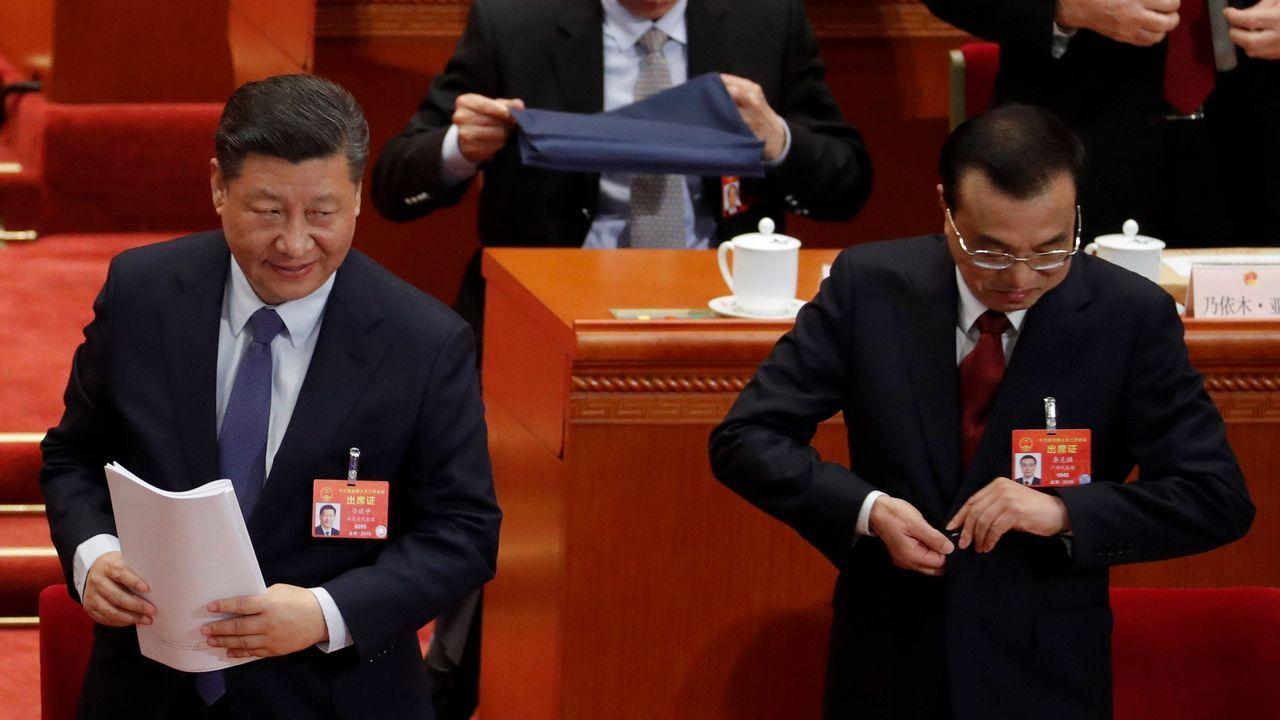 Oficina de empleo.El presidente Xi Jinping y el primer ministro Li Keqiang  en la segunda sesión de la Asamblea Nacional Popular