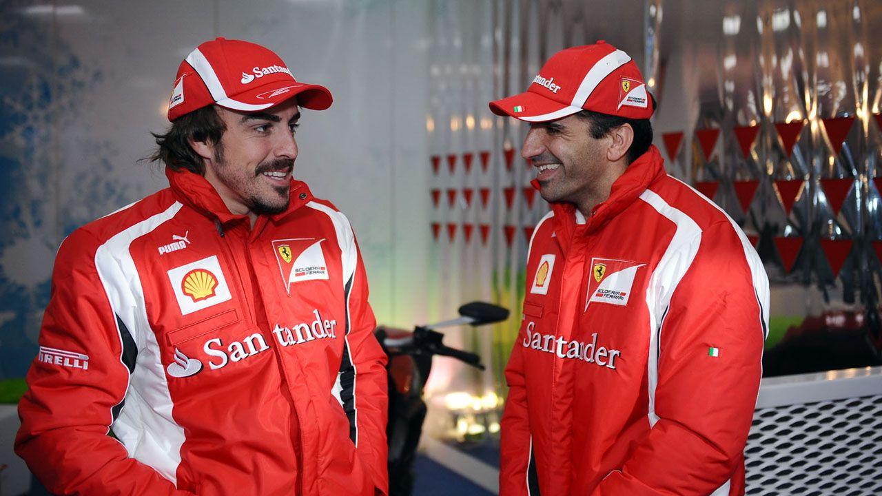 .Alonso y Gené durante la etapa del piloto asturiano en Ferrari, en 2011