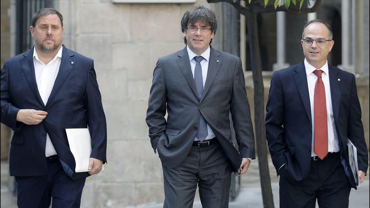Aprobada la ley de referendo.Oriol Junqueras, Carles Puigdemont y Jordi Turull