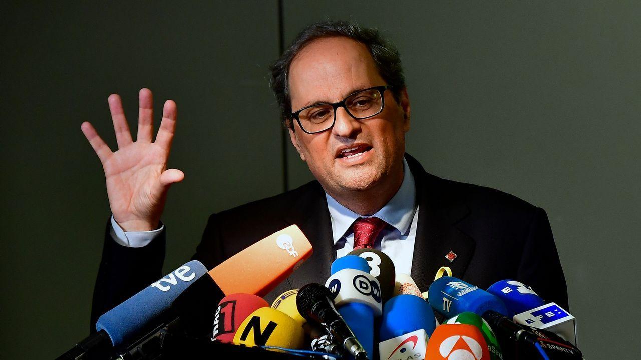 Torra: «Cataluña está esperando a sus políticos honorables».Irene Montero y Pablo Iglesias, en el Congreso