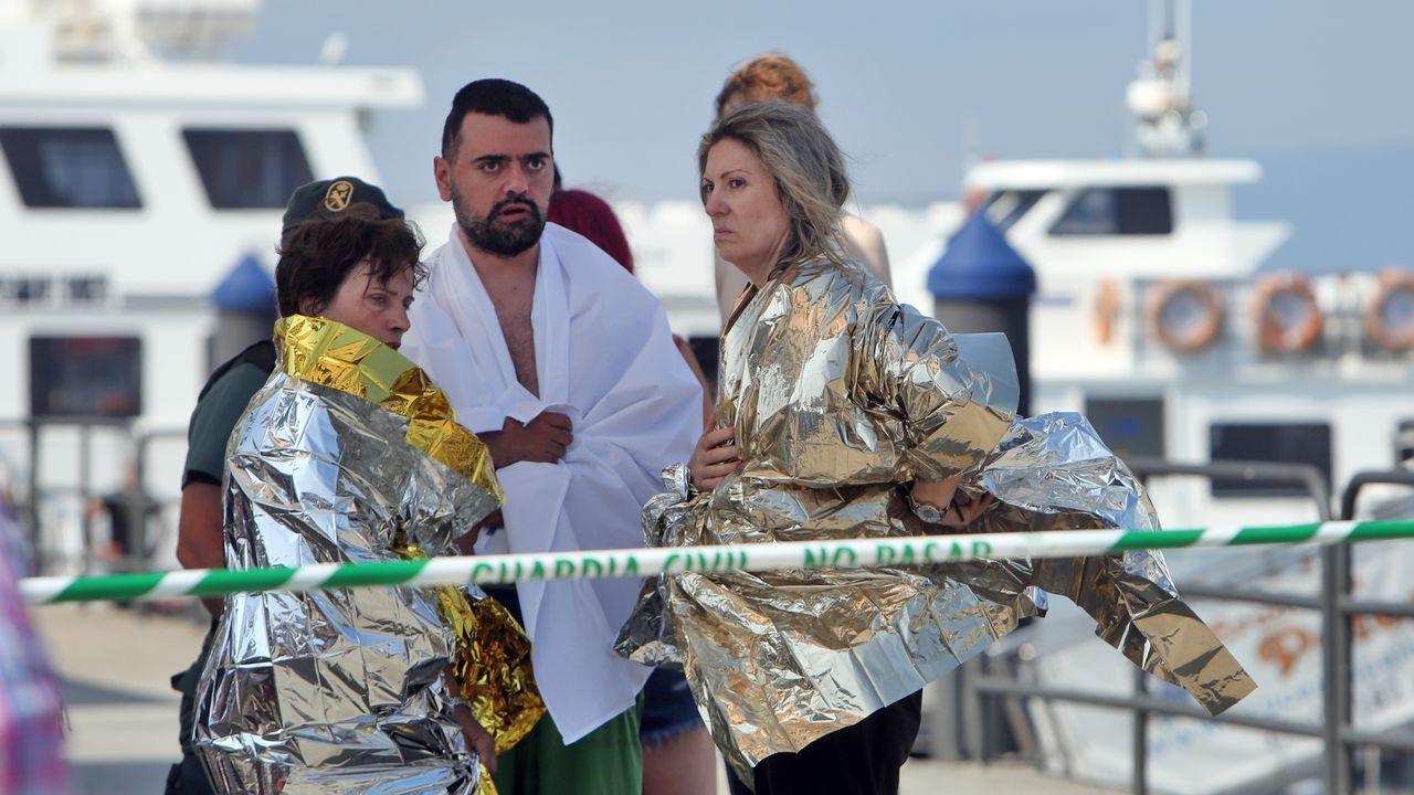 Los heridos fueron atendidos por personal sanitario en el muelle de O Corgo, O Grove