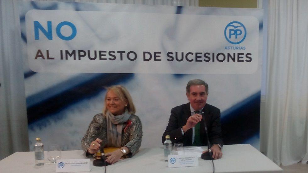 Mariano Rajoy, con Mercedes Fernández y Susana López Ares, delante de Isidro Fernández Rozada y Ovidio Sánchez..Mercedes Fernández y Carlos Rodríguez de la Torre