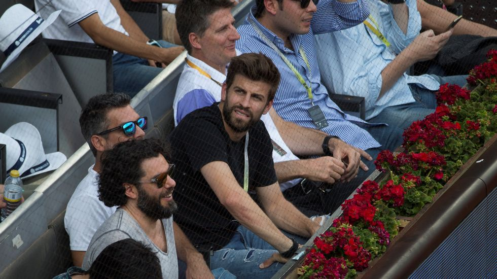 Gerard Piqué interrumpe un saque de David Ferrer en el Mutua Madrid Open