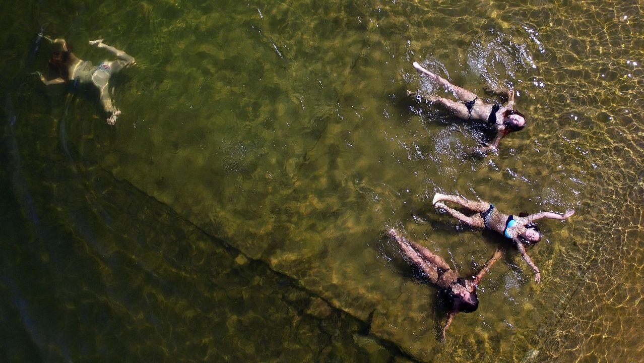 Un pueblo de Córdoba bate el récord histórico de calor en España con 46,9 grados.Chapuzón en el río Yenisei para combatir el calor.