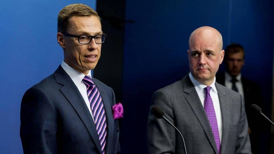.Primer Ministro de Suecia escucha al Primer Ministro de Finlandia, Alexander Stubb
