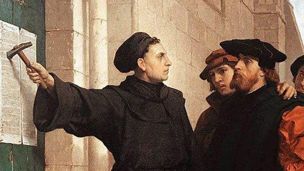 Lutero clava el texto de sus 95 tesis en la puerta de la iglesia de Todos los Santos de Wittenberg. Obra de Ferdinand Pauwels (1872), Wartburg-Stiftung, Eisenach (Alemania)