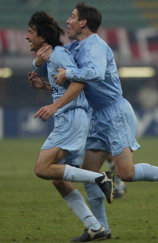Celebrando un gol con el actual técnico del Celta.