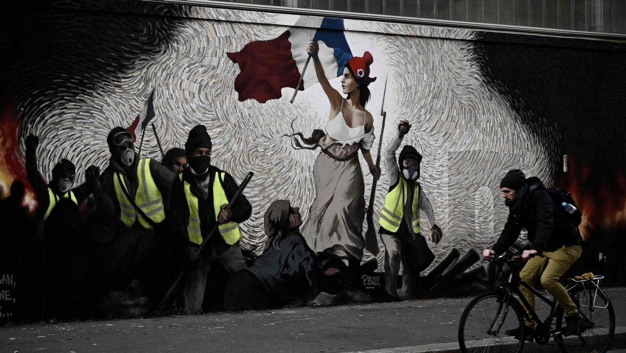 Un grafiti reinterpreta la célebre obra de Delacroix incluyendo a los chalecos amarillos