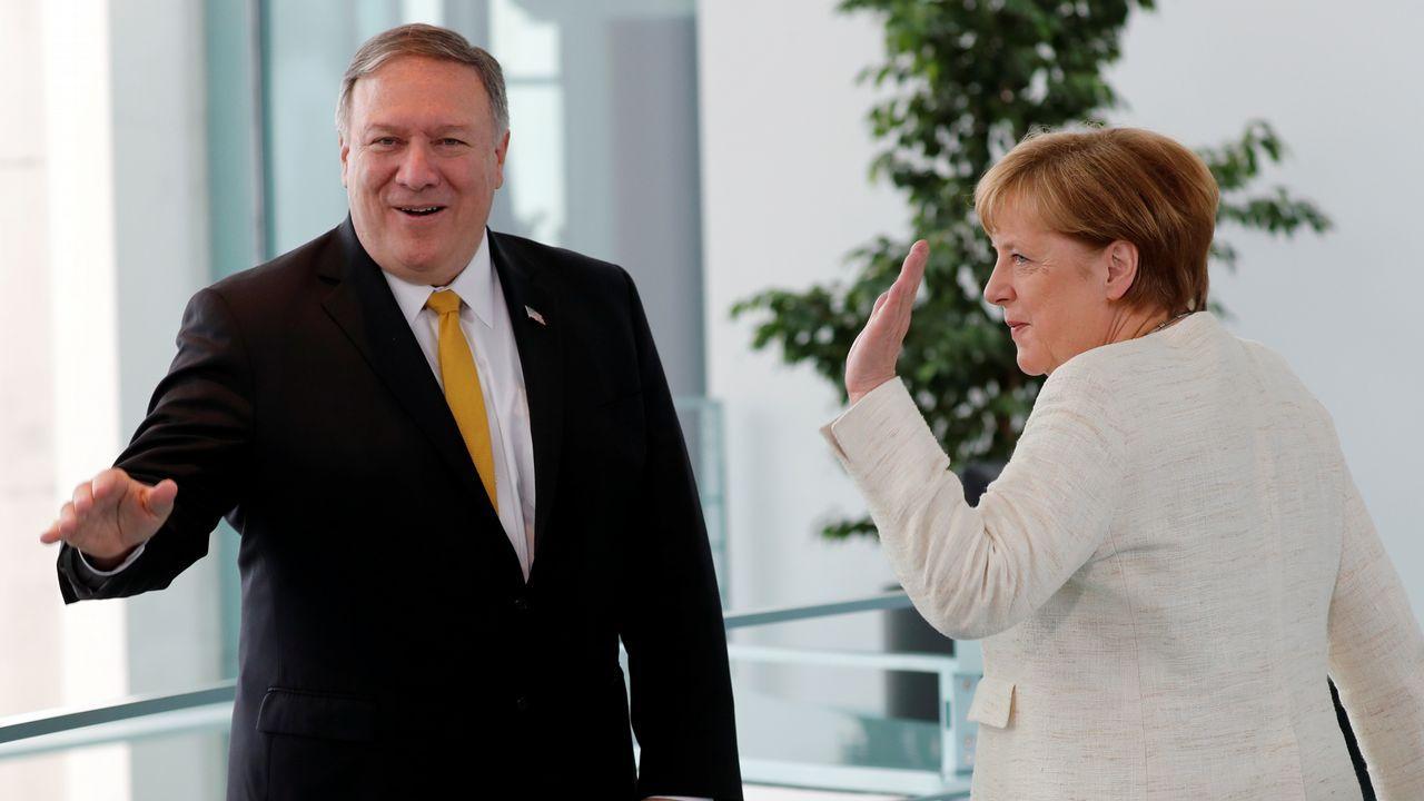 La visita de Trump a la capital británica, en imágenes.Mike Pompeo y Angela Merkel, ayer, durante la visita del secretario de Estado a Berlín.