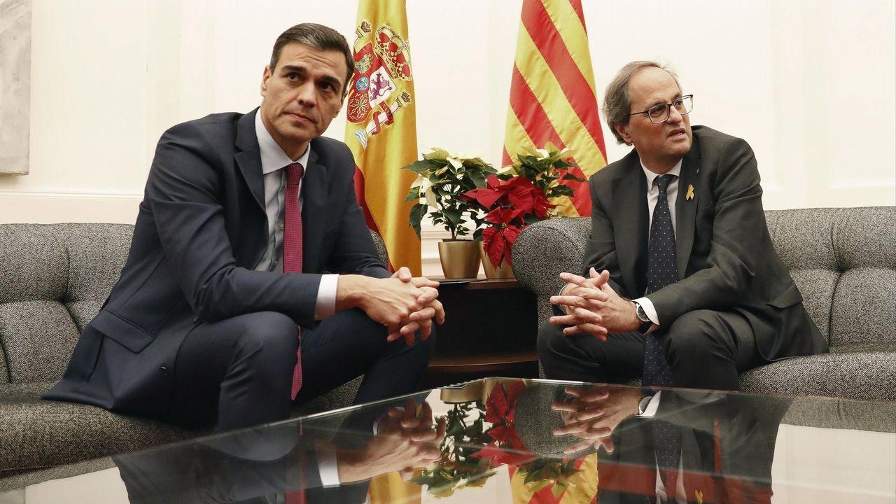 El presidente del Gobierno, Pedro Sánchez, y el de la Generalitat, Quim Torra, durante su encuentro el pasado diciembre en el palacio de Pedralbes, en Barcelona.
