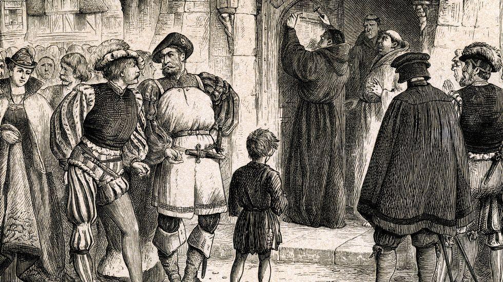 . Lutero fixando as súas teses na porta da capela do castelo de Wittenberg