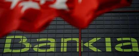 Los abultados números rojos de Bankia lastraron las cuentas de la banca en la primera mitad del año pasado.