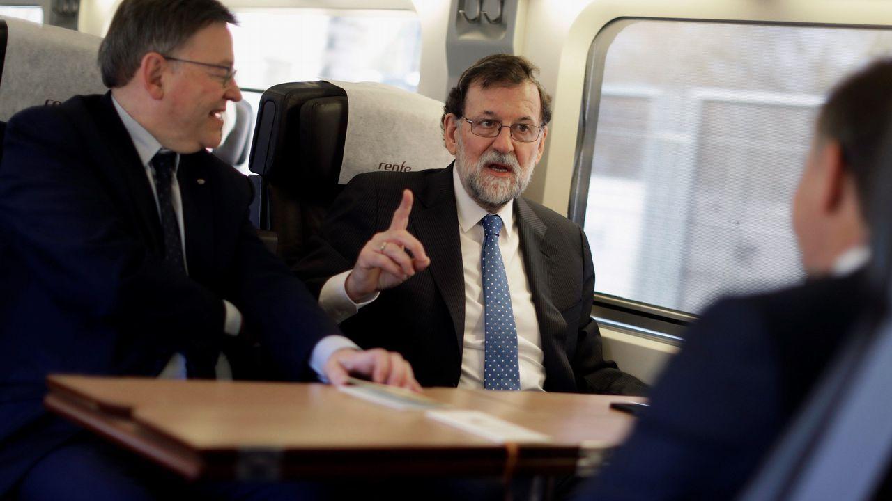 Feijoo da un nuevo paso en Madrid como hombre fuerte del PP.Rajoy junto al presidente de la Generalitat, Ximo Puig