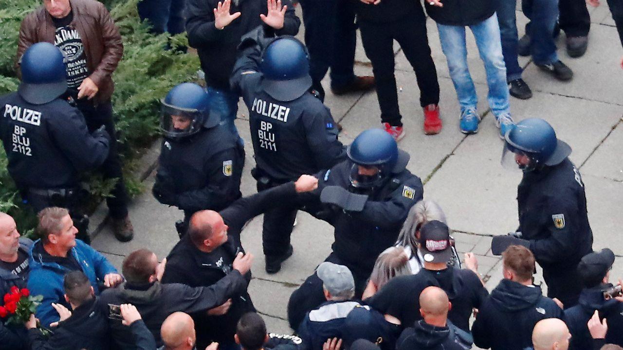 Merkel, en una foto de archivo junto al relevado Maassen