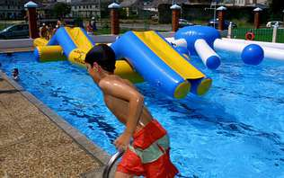 As piscinas están estes días máis cheas que no mes de xullo | ÓSCAR CELA