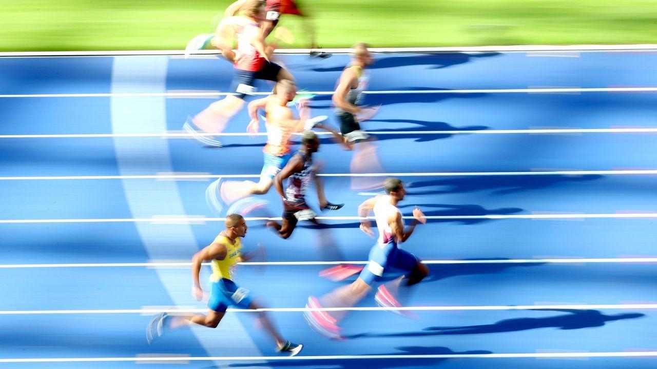 Primera ronda de la prueba de los 100 metros masculina en el estadio olimpico de Berlin